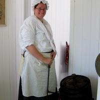 photo of woman churning butter at molson house